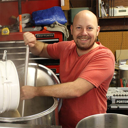 Gerad Coles, Founder and Brewmaster of Prairie Dog Brewing mashing in.
